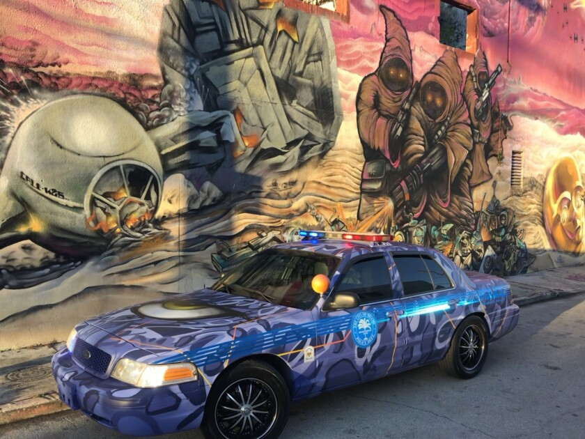 The Miami Police Department decomissioned this 2009 Ford Crown Victoria patrol car into a vehicle that looks like Wynwood, where it will be used for community events. Graffiti artist Abstrk painted the car with deep blues, purples and shapes.