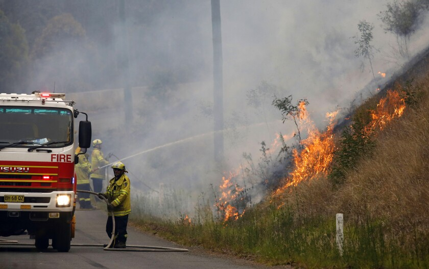 Australian firefighters work on a controlled burn in Koorainghat, New South Wales state on Monday.