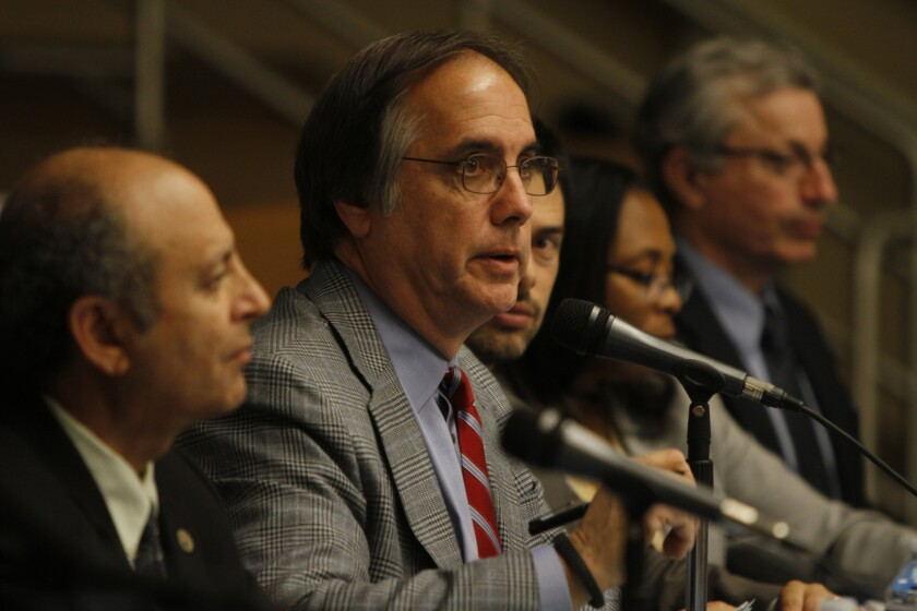 The South Coast Air Quality Management District board fired Barry Wallerstein, center, the agency's longtime leader, despite pleas from environmentalists and public health experts.