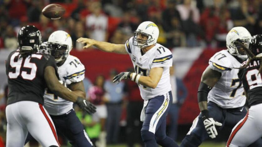 San Diego Chargers quarterback Philip Rivers throws to Antonio Gates for a first down catch against the Falcons in overtime in Atlanta.
