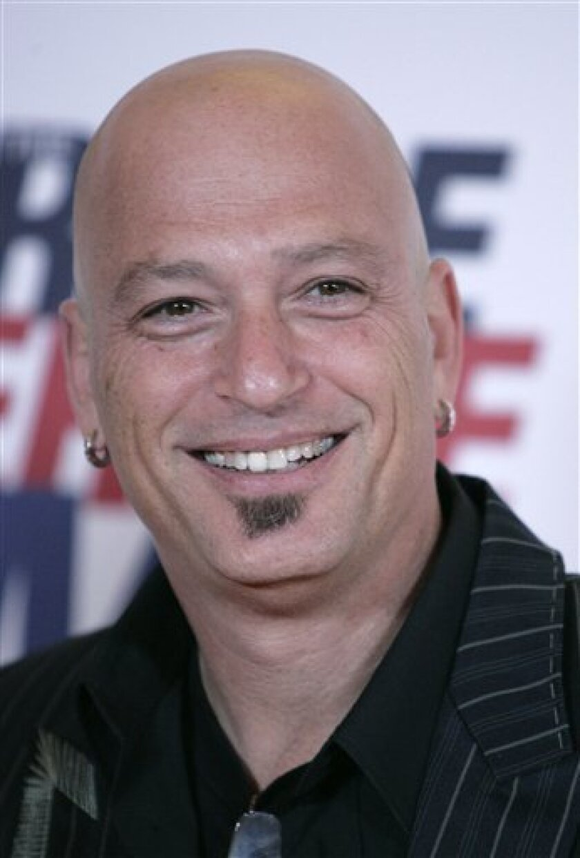 A May 2, 2008, file photo shows Howie Mandel  in Los Angeles.   Mandel has been hospitalized in Toronto with an irregular heartbeat a spokesman for the 53-year-old comedian and game show host said Monday Jan. 12, 2009. (AP Photo/Matt Sayles/file)