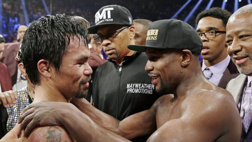 Manny Pacquiao, left, and Floyd Mayweather Jr. after their fight in 2015