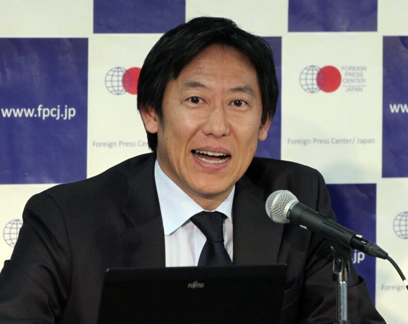 Seoul Olympics swimming gold medalist Daichi Suzuki speaks during a press conference in Tokyo, Friday, Nov. 6, 2015. Suzuki, the head of the new Japan Sports Agency, said Japan aims to increase its medal count in future Olympics. (AP Photo/Ken Moritsugu)