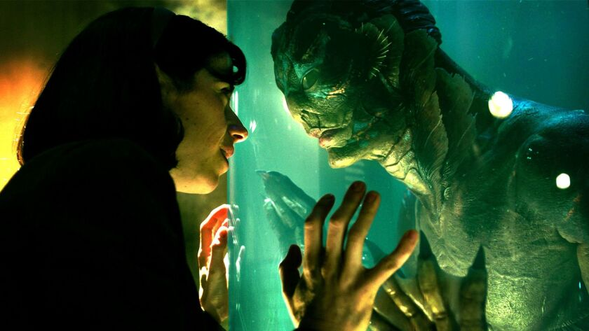 Doug Jones as the creature, as seen in the final film, with co-star Sally Hawkins.