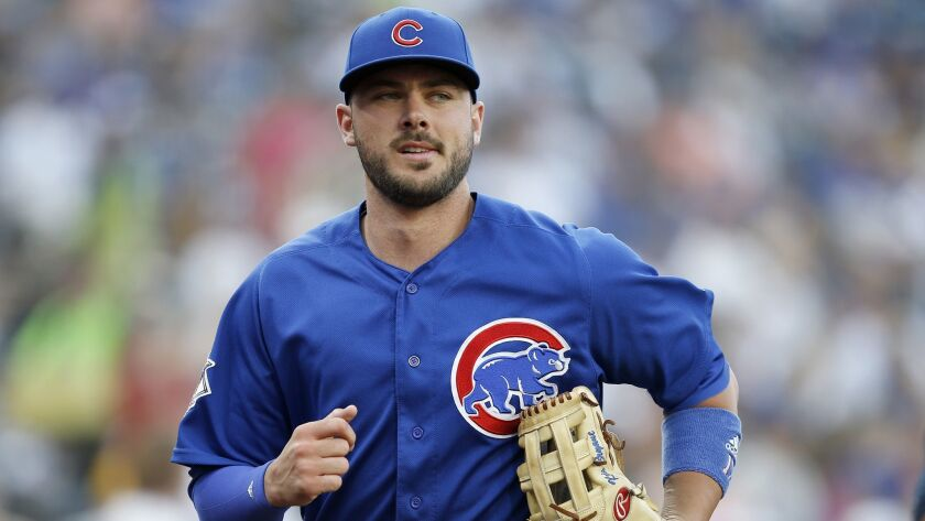 Chicago Cubs third baseman Kris Bryant runs into the clubhouse after warm ups before a baseball game