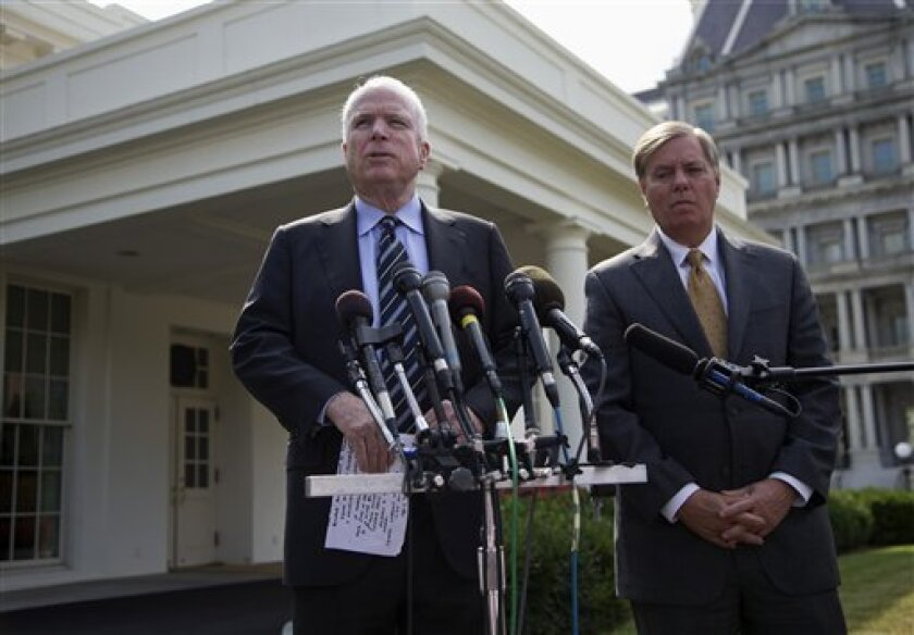 Sen. John McCain, R-Ariz., left, accompanied by Sen. Lindsey Graham, R-S.C., speaks with reporters outside the White House in Washington, Monday, Sept. 2, 2013, following a closed-door meeting with President Barack Obama to discuss the situation with Syria. President Barack Obama, working to persuade skeptical lawmakers to endorse a U.S. military intervention in civil war-wracked Syria, hosted the two leading Capitol Hill foreign policy hawks for talks and directed his national security team to