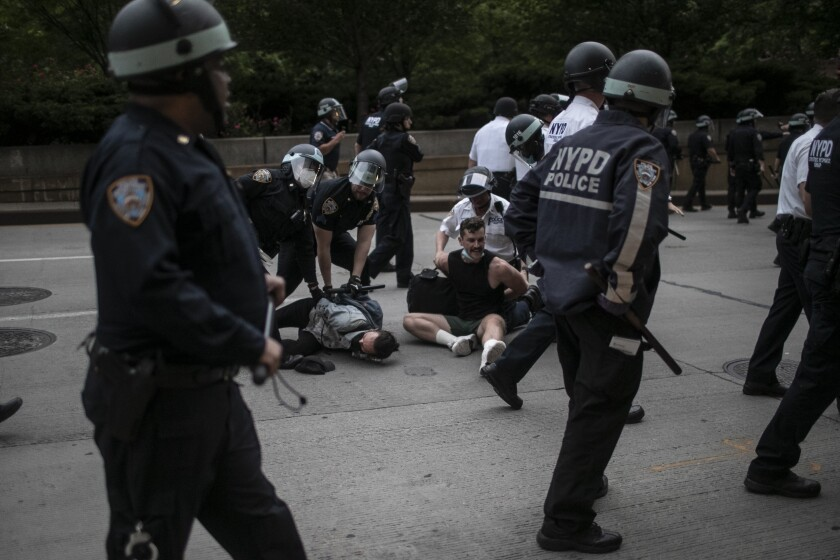 Police arrest protesters on Tuesday, June 2, 2020, in New York.