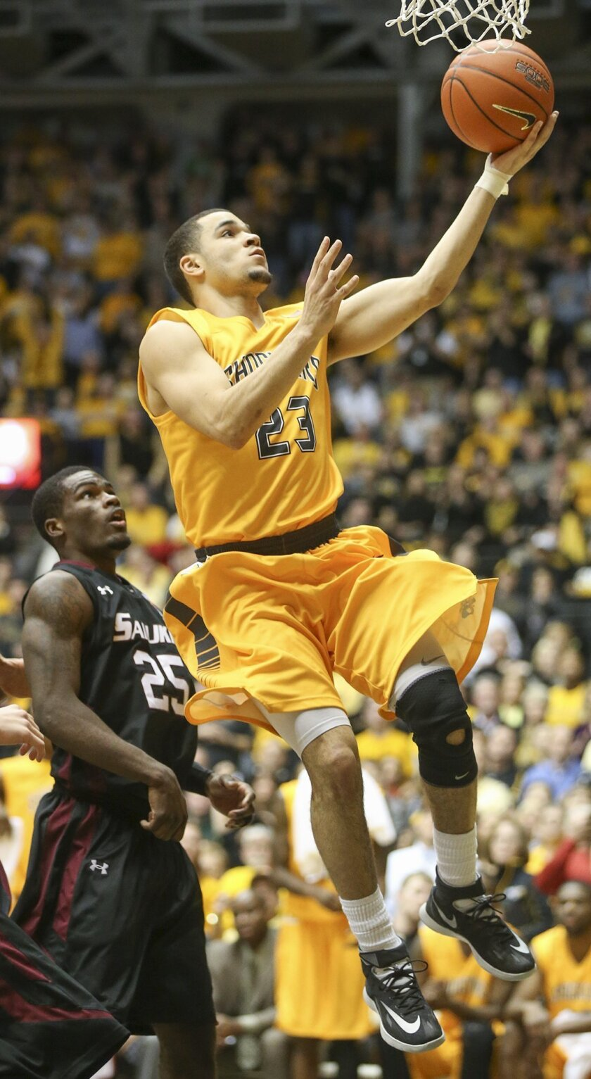 Wichita State's Fred VanVleet (23) goes to the basket against Southern Illinois' Anthony Beane during the second half of an NCAA college basketball game Tuesday, Feb. 11, 2014, in Wichita, Kan. Wichita State won 78-67. (AP Photo/The Wichita Eagle, Fernando Salazar) LOCAL TV OUT; MAGS OUT; LOCAL RADIO OUT; LOCAL INTERNET OUT