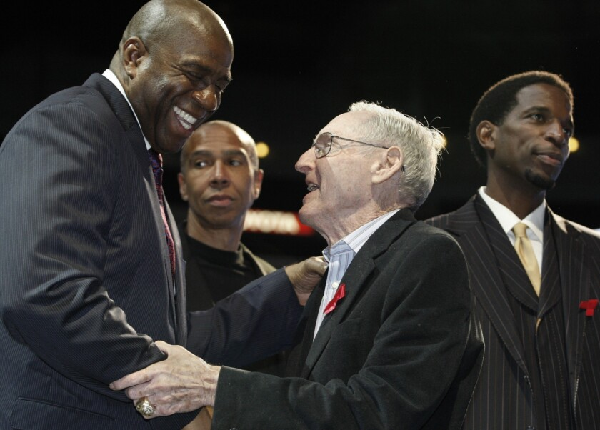 Former Lakers Coach Bill Sharman, right, is greeted by Lakers great Magic Johnson during a news conference in 2011. Sharman, who coached the Lakers to the 1972 NBA title, is still finding ways to make an impact in people's lives at the age of 87.