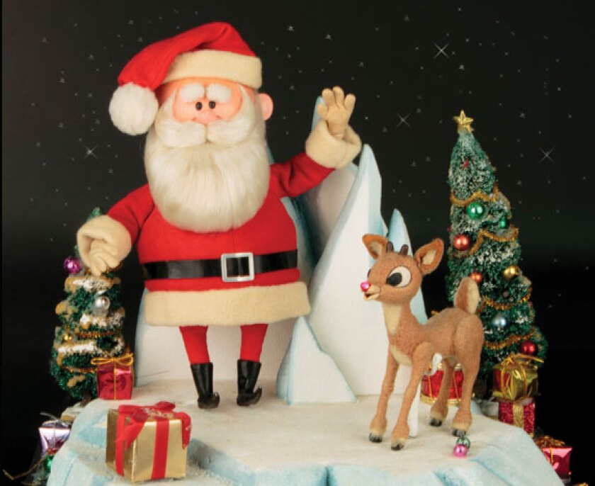 """Rudolph and Santa Claus figures that were featured in """"Rudolph the Red-Nosed Reindeer"""" are going up for auction."""