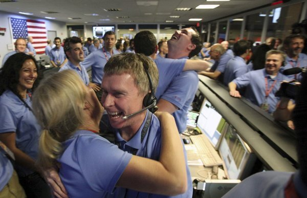 """Curiosity survives the dreaded """"Seven Minutes of Terror"""" and lands successfully on Mars. Staffers at the Jet Propulsion Laboratory in La Canada Flintridge (and people around the world) celebrate."""