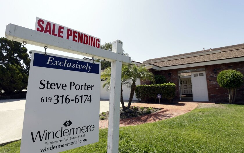 FILE - In this Wednesday, Aug. 14, 2013, file photo, a home is for sale in San Diego.