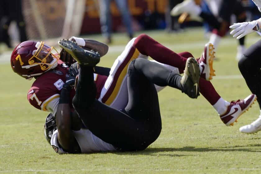 Washington Football Team quarterback Dwayne Haskins (7) is sacked by Baltimore Ravens outside linebacker Matt Judon (99) during the first half of an NFL football game, Sunday, Oct. 4, 2020, in Landover, Md. (AP Photo/Susan Walsh)