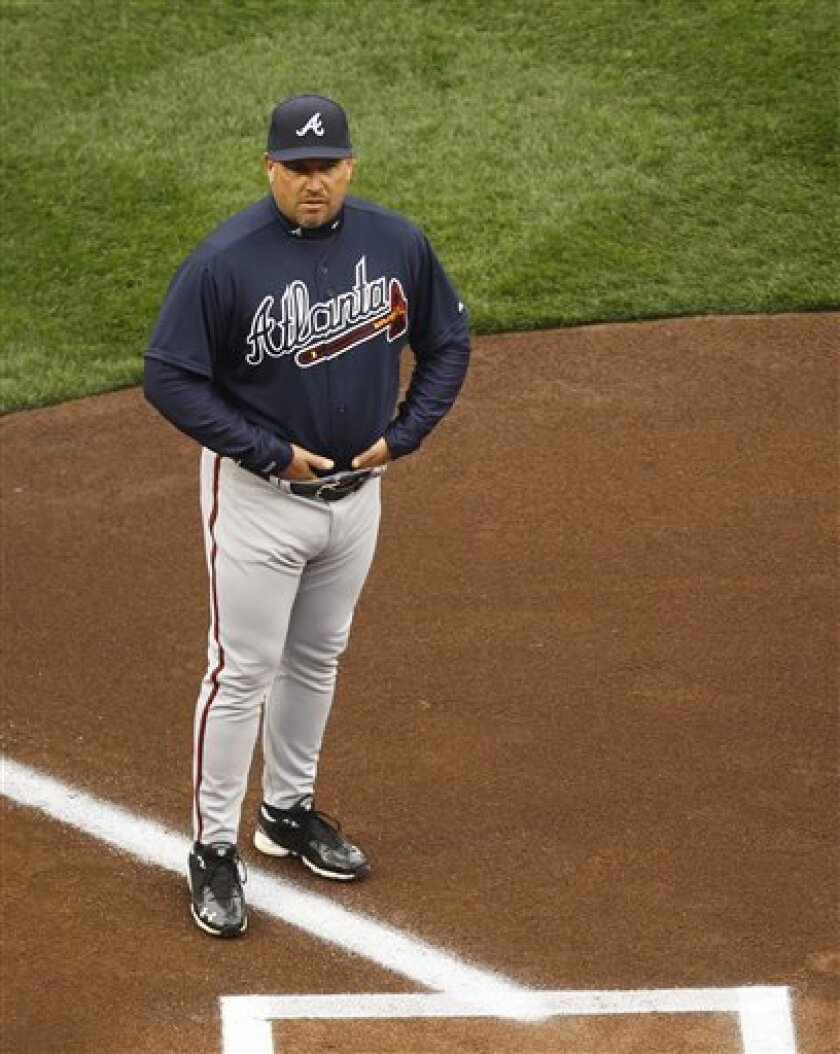 Atlanta Braves manager Fredi Gonzalez stands near home before their opening day baseball game with the Washington Nationals on Thursday, March 31, 2011 in Washington.(AP Photo/Alex Brandon)