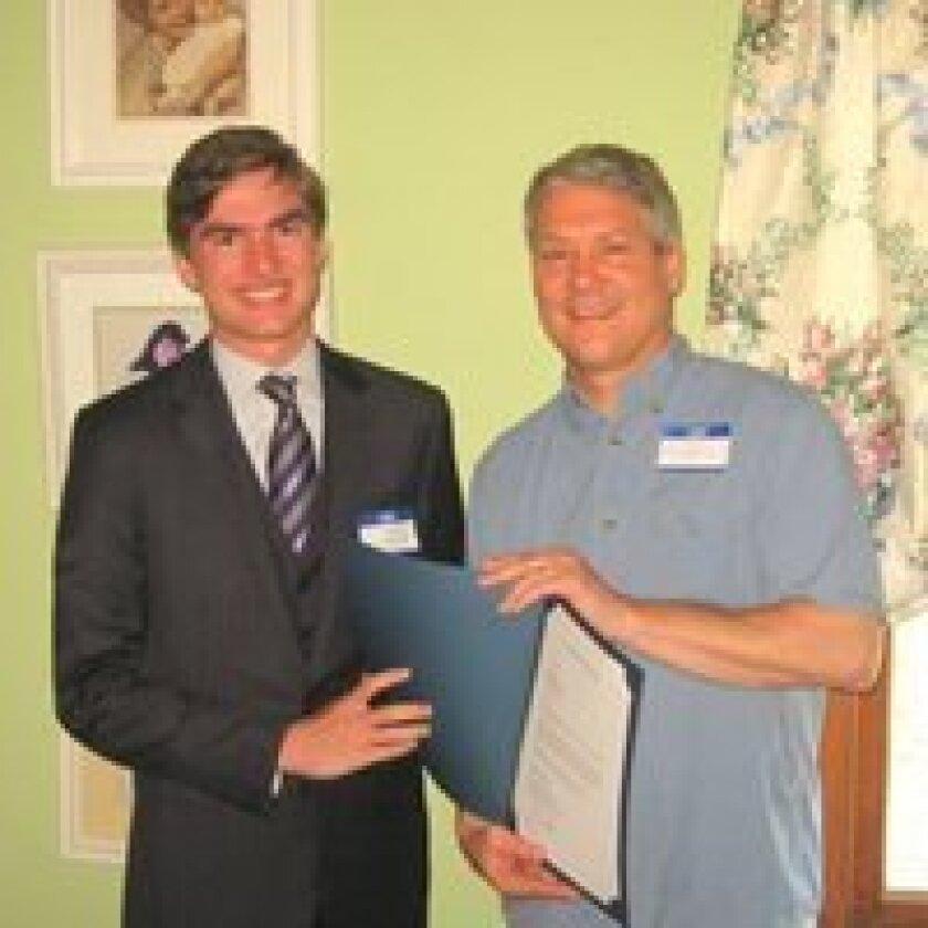 Dillon Lerach (left) receives his award.