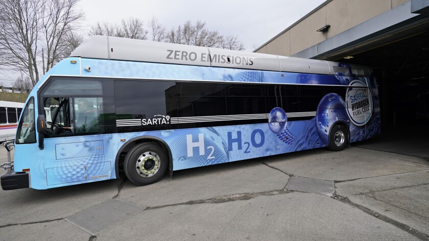 Kevin Baker, a maintenance technician, drives a hydrogen fuel cell bus out of the terminal, Tuesday, March 16, 2021, in Canton, Ohio. Hydrogen, the most abundant element in the universe, is increasingly viewed as a vital answer to troubling questions about how to slow the catastrophic effects of climate change attributed to the planet's 1.2 billion cars and trucks, nearly all of which burn gasoline and diesel. (AP Photo/Tony Dejak)