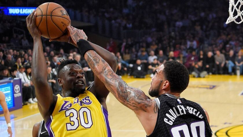 Lakers forward Julius Randle, left, shoots as Sacramento Kings center Willie Cauley-Stein defends during the first half on Tuesday.