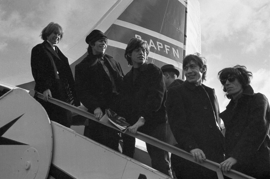 The Rolling Stones board a New York-bound plane at London Airport in 1964.