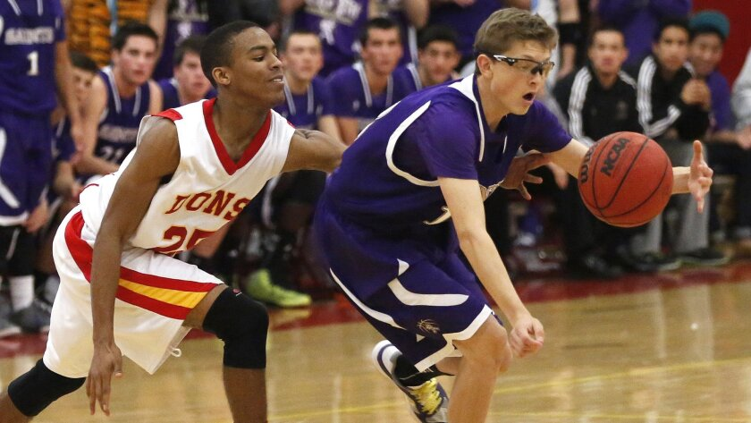 Cathedral Catholic's Brandon Michel (left) reaches for the ball against St. Augustine's Eric Monroe.