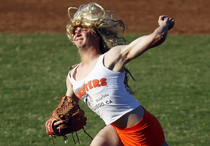 Kendall Lindley pitches as members of the SDSU baseball team participated in their second annual Halloween Game at Tony Gwynn Stadium.