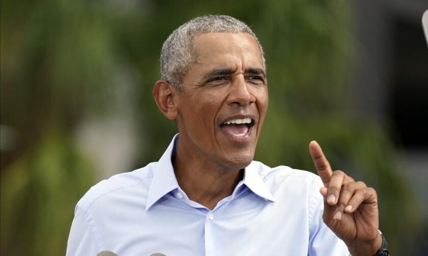 Former President Obama speaks in favor of Joe Biden, his former vice president, on Tuesday in Orlando, Fla.