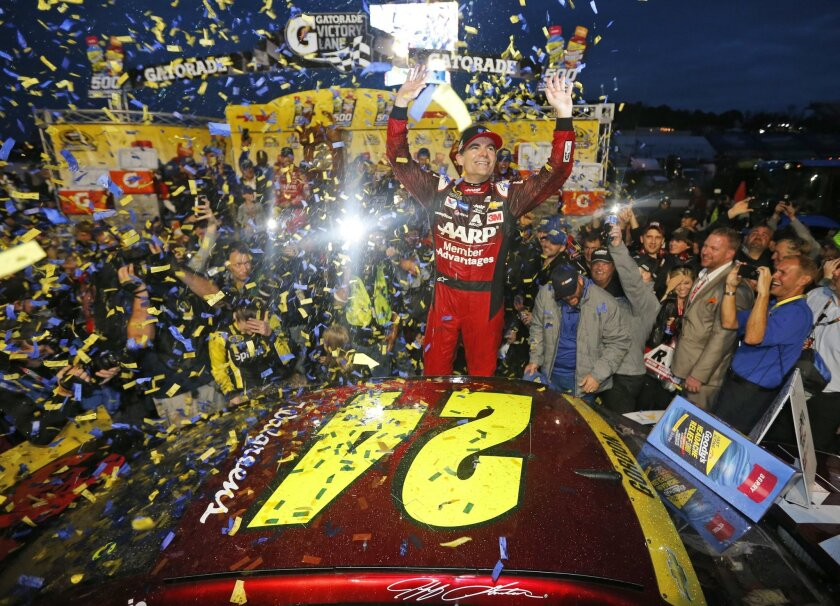 Jeff Gordon celebrates after winning the NASCAR Sprint Cup Series auto race at Martinsville Speedway in Martinsville, Va., Sunday, Nov. 1, 2015. (AP Photo/Steve Helber)