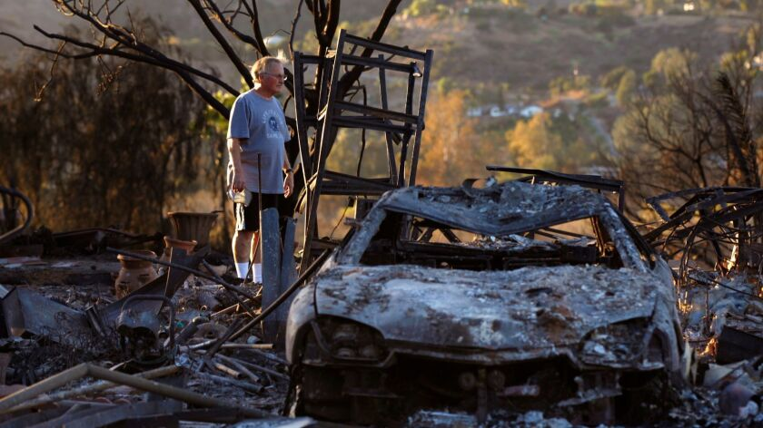 Dick Barton looks over his burned-out home at the Rancho Monserate Country Club on Monday, Dec. 11, 2017. The home, where he and his wife, Paula, had lived for 12 years, was destroyed in the Lilac fire.
