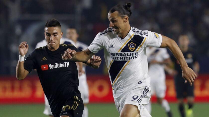 CARSON, CALIF. - AUG. 24, 2018. LAFC midfielder Eduard Atuesta battles for control of the ball agai