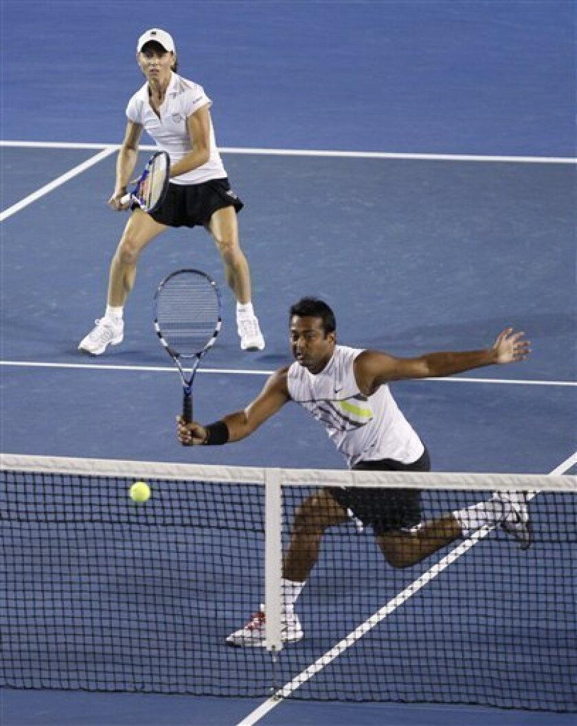 Leander Paes of India, bottom, and Cara Black of Zimbabwe, top, play Ekaterina Makarova of Russia and Jaroslav Levinsky of Czech Republic during the Mixed doubles final match at the Australian Open tennis championship in Melbourne, Australia, Sunday, Jan. 31, 2010. (AP Photo/John Donegan)