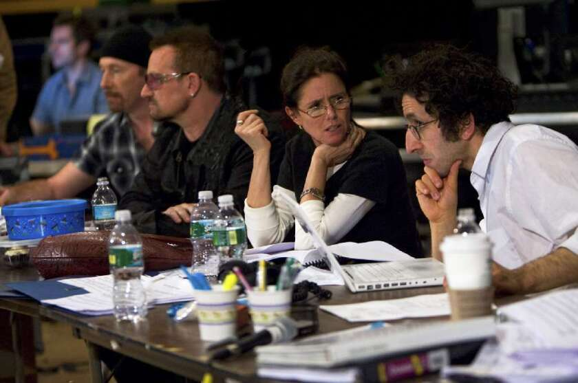 """Glen Berger, far right, confers with Julie Taymor during a rehearsal of """"Spider-Man: Turn Off the Dark."""""""