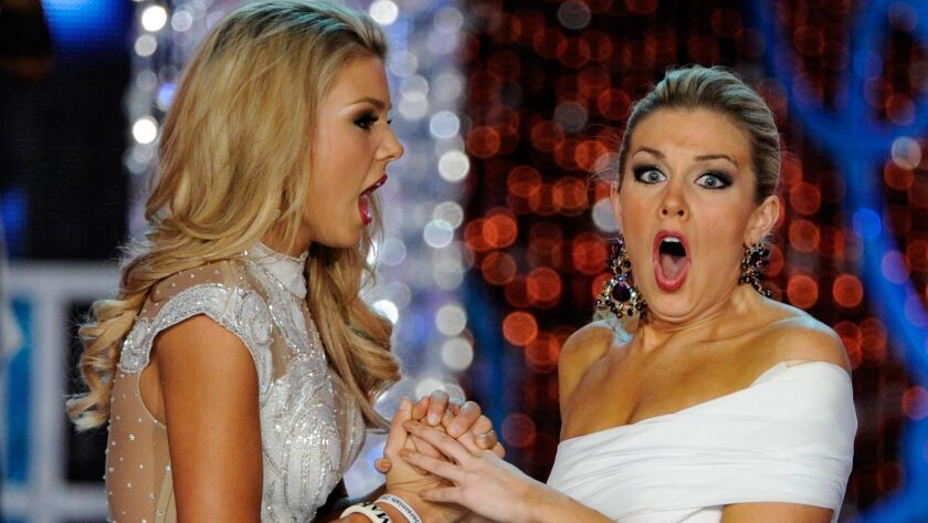 Ali Rogers, left, Miss South Carolina, and Mallory Hytes Hagan, Miss New York, react after the announcement of the new Miss America in 2013.