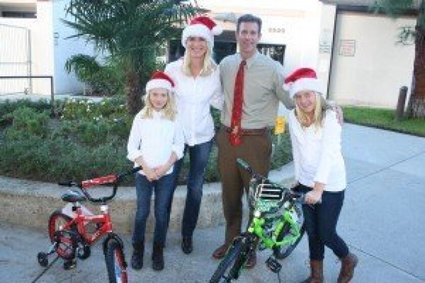 Solana Highlands Principal Jerry Jones received donations of new bikes from Catryn, Carolyna and Emily Fowler for the Care and Share program at Solana Highlands, helping provide a good holiday for district families who are less fortunate. Photo/Karen Billing