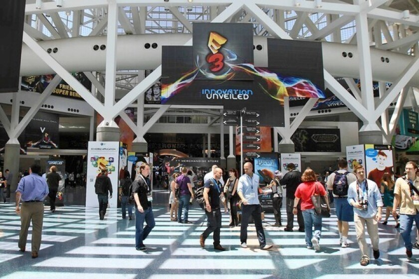 In a ranking of the 50 most popular convention cities by sales, Los Angeles came in 17th, far behind top-ranked Orlando, Fla., according to an analysis by Cvent Inc., a convention management and technology firm. Above, the E3 video game conference at the Los Angeles Convention Center in June.