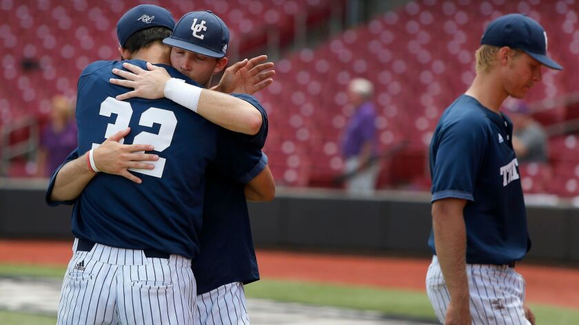 UC San Diego Tritons shortstop Tyler Howsley hugs teammate Preston Mott (32) following a 5-2 loss in