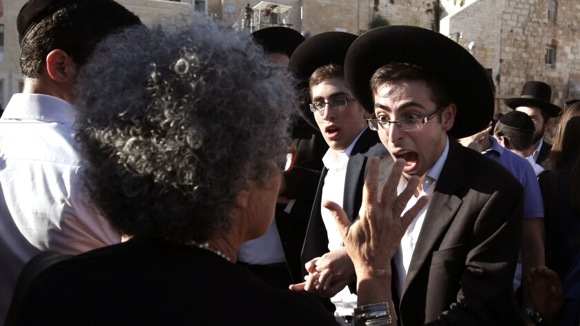 An Orthodox Jewish man yells at an woman advocating egalitarian prayer at the Western Wall in Jerusalem's Old City on June 16.