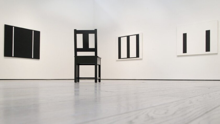 Abstract paintings by John McLaughlin (1898-1976) are echoed in a chair design by Roy McMakin.