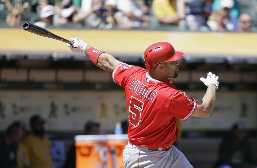 Angels slugger Albert Pujols hits a two-run home run off Athletics ace Sonny Gray in the second inning.