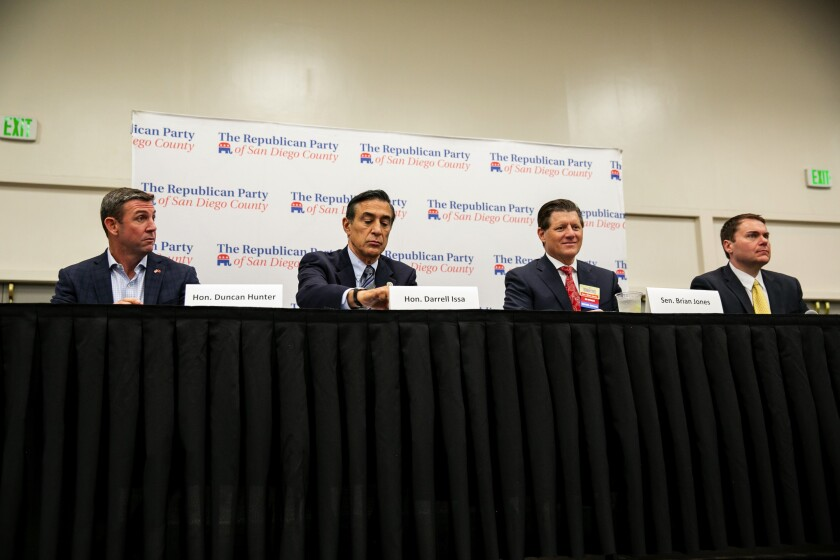 Republican candidates for the 50th Congressional District include Rep. Duncan Hunter, left, who has not withdrawn, along with former Rep. Darrell Issa, state Sen. Brian Jones and former San Diego Councilman Carl DeMaio. They took part in a candidate forum in October.