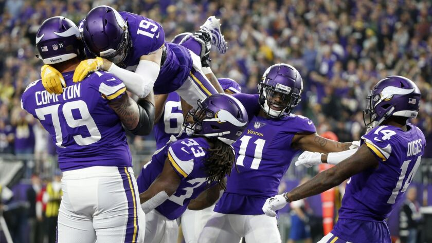 Minnesota Vikings running back Dalvin Cook (33) celebrates with teammates after catching a 26-yard t