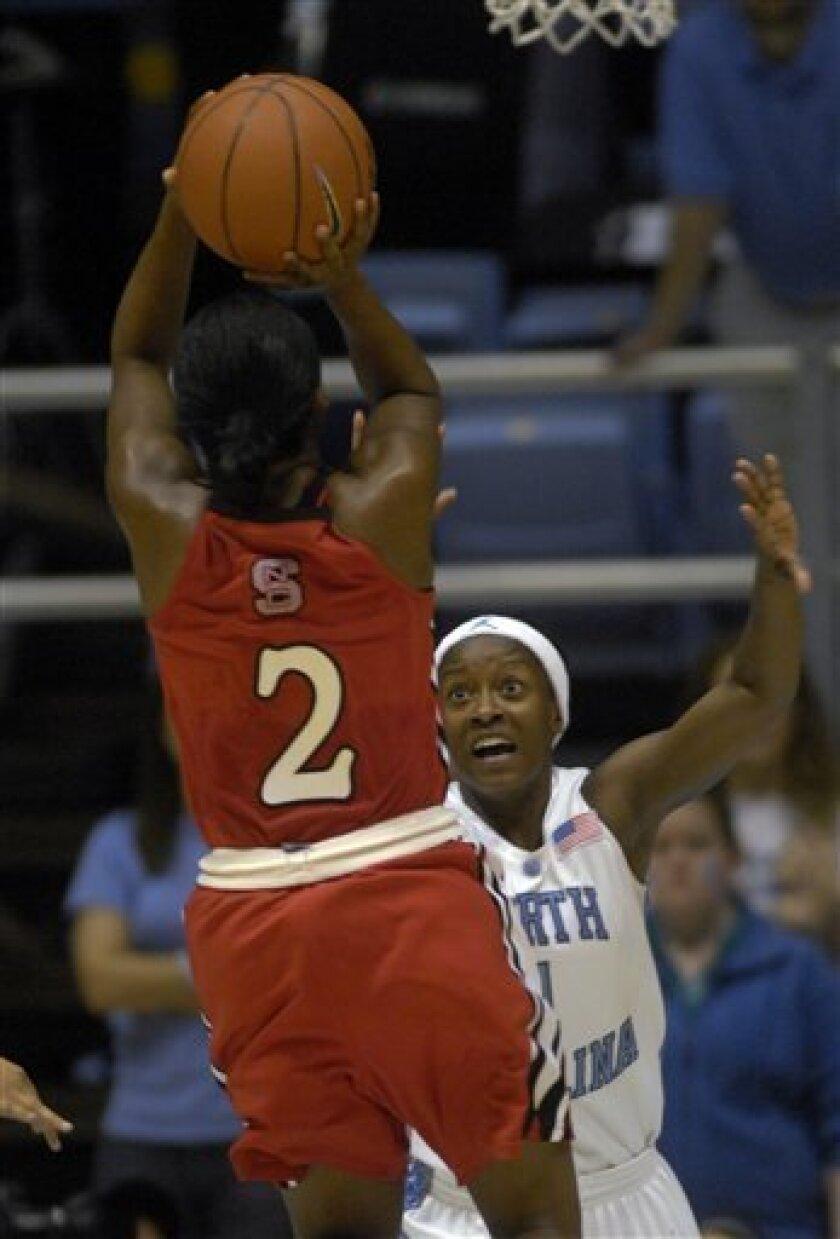 North Carolina State's Nikitta Gartrell (2) shoots over North Carolina's She'la White (1) during the first half of an NCAA college basketball game in Chapel Hill, N.C., Sunday, Jan. 11, 2009. (AP Photo/Sara D. Davis)