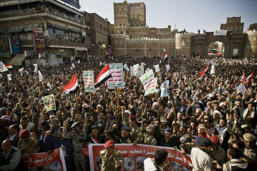 Shiite rebels, known as Houthis, chant slogans to protest against Saudi-led airstrikes, during a rally in Sanaa, Yemen, Wednesday, April 1, 2015. Saudi-led coalition warplanes bombed Shiite rebel positions in both north and south Yemen early Wednesday, setting off explosions and drawing return fire from anti-aircraft guns. (AP Photo/Hani Mohammed)