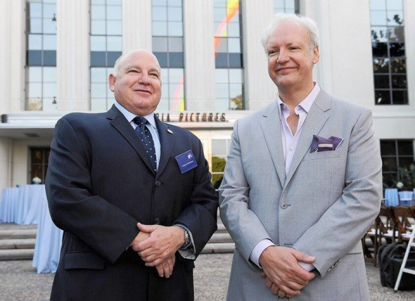 Culver City Mayor Andrew Weissman, left, with artist Tony Tasset. Weissman owes the federal and state governments $550,000 in unpaid taxes, penalties and interest.