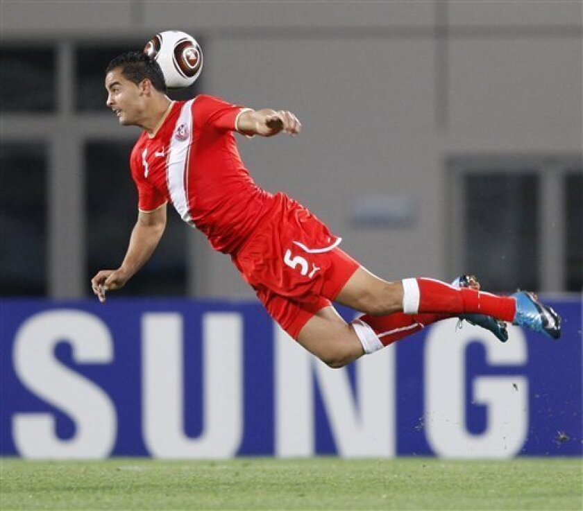 Tunisia's Ammar Jemal soars for a header in Tunisia's African Cup of Nations Group D soccer match against Zambia at Tundavala Stadium in Lubango, Angola Wednesday, Jan. 13, 2010. (AP Photo/Rebecca Blackwell)