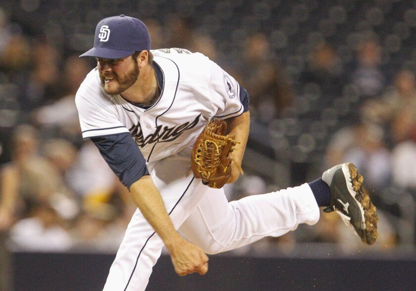 The Padres' Cory Mazzoni pitches to the Astros in the ninth inning.