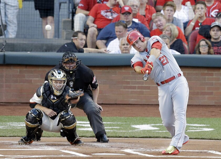 American League's Mike Trout, of the Los Angeles Angels, hits a home run during the first inning of the MLB All-Star baseball game, Tuesday, July 14, 2015, in Cincinnati. (AP Photo/Michael E. Keating )