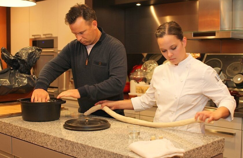 William Bradley, executive chef of Addison at The Grand Del Mar, is assisted by Sous Chef Stefani de Palma during the 'One Chef, One Dish, One San Diego' cooking demo and charity fundraiser at Harvard Cookin' Girl kitchens in La Jolla; May 19, 2015.