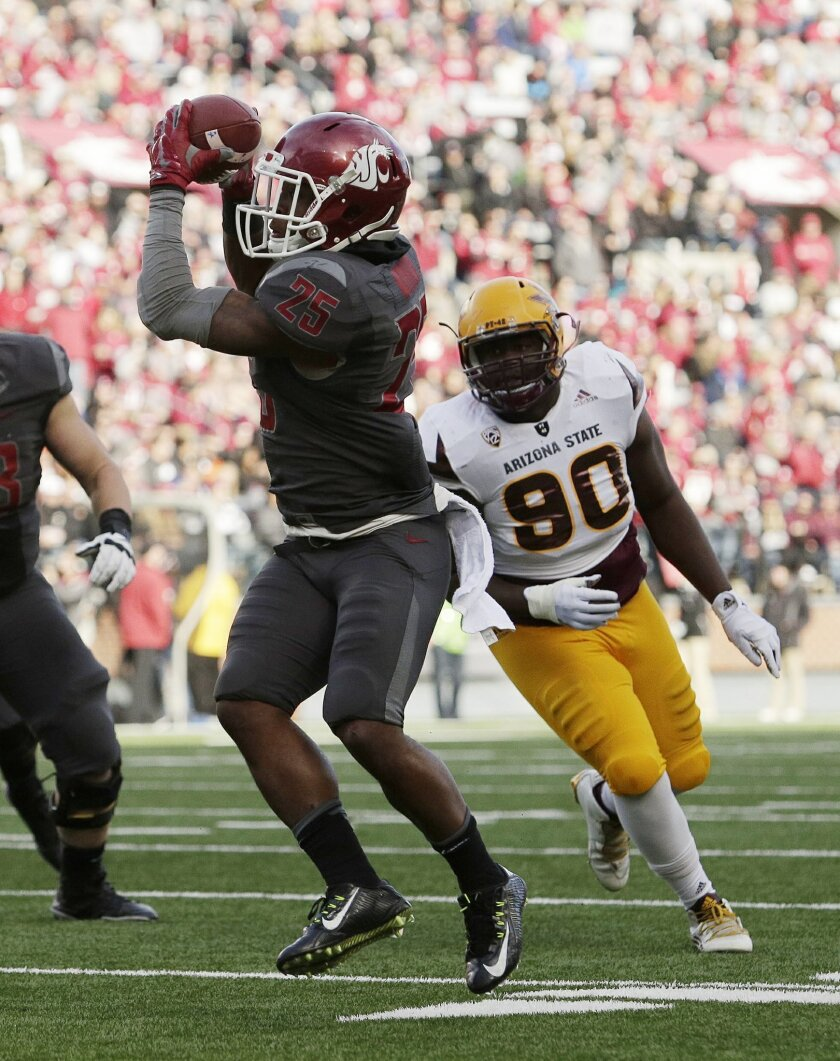 Washington State running back Jamal Morrow (25) makes a catch in front of Arizona State defensive lineman Tashon Smallwood (90) during the first half of an NCAA college football game, Saturday, Nov. 7, 2015, in Pullman, Wash. (AP Photo/Young Kwak)