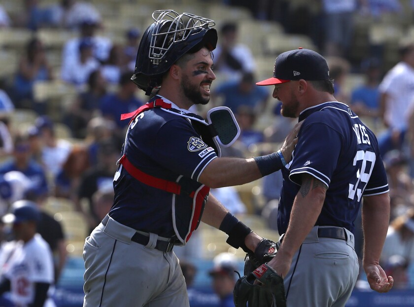 Padres closer Kirby Yates, greeted by catcher Austin Hedges after a 5-3 win Sunday at Dodger Stadium, became the 18th player in history to collect 30 saves by the All-Star break.