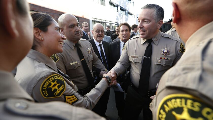 MONTEREY PARK, CA-DECEMBER 3, 2018: Alex Villanueva, right, the new Los Angeles County Sheriff, gr