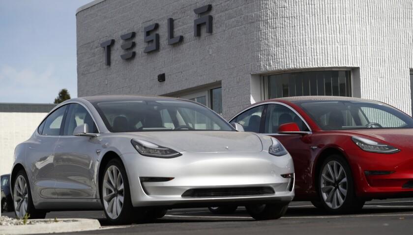 Model 3 cars at a Tesla dealership in Colorado.
